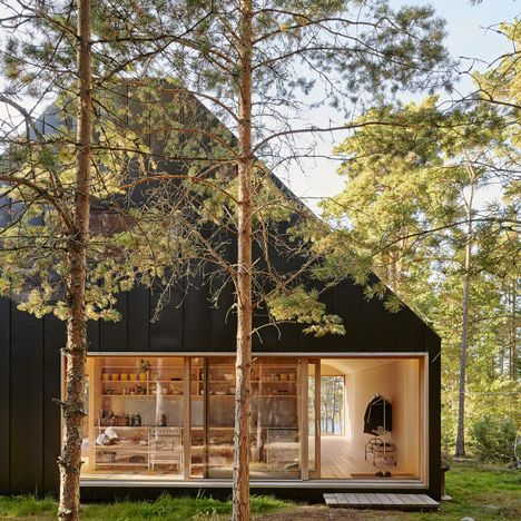Behind the black steel exterior of this home on the Stockholm archipelago, Tham & Videgård Arkitekter has created a living space with vaulted ceilings.