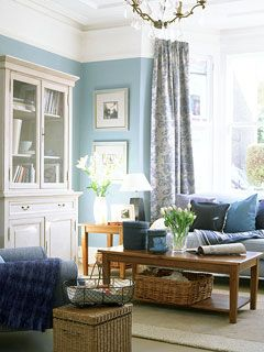 Nothing soothes like blue . . . love the tall bookcases (I'm going to assume this one is to the right of a gorgeous fireplace, with a matching one on the other side).