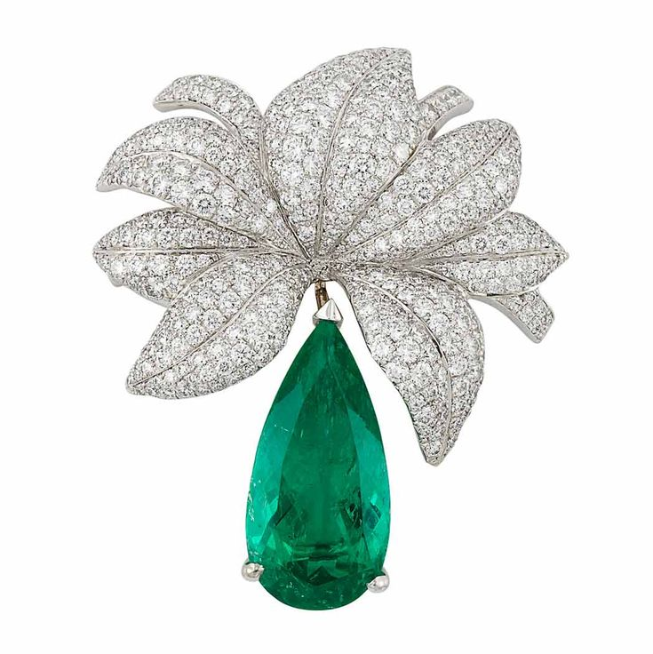 White Gold, Diamond and Emerald Clip-Brooch, Chopard  18 kt., topped by a cluster of bombe leaves pave-set with round diamonds approximately 3.75 cts., supporting one pear-shaped emerald approximately 5.03 cts., signed Chopard, nos. 3268138 and 909132.
