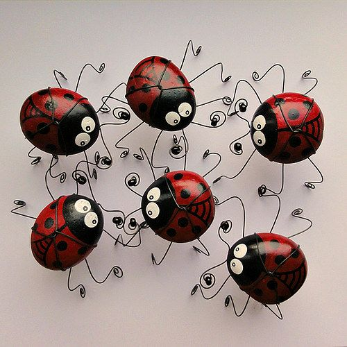 Cute idea..... Stones painted like lady bugs and strong bent wire for feet