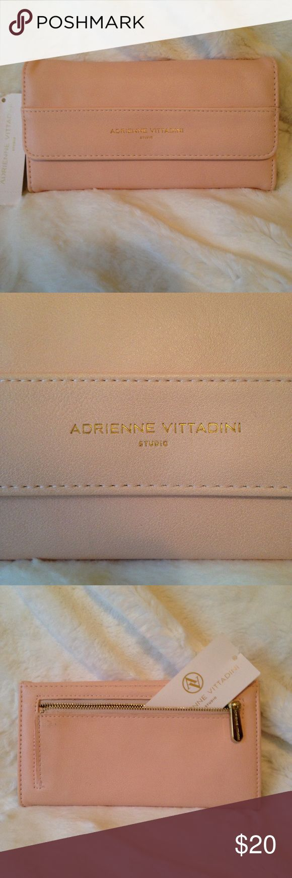 NWT ADRIENNE VITTADINI Wallet Gorgeous Spring Color! Blush ADRIENNE VITTADINI Wallet Features ID Slot 12 Credit Card Slots 4 Bill Slots and 2 Coin Pockets Adrienne Vittadini Bags Wallets