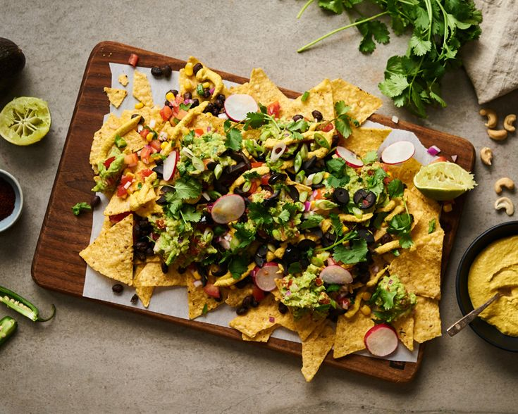 This tower of vegan nachos is perfect for any day of the week. #vegan #nachos