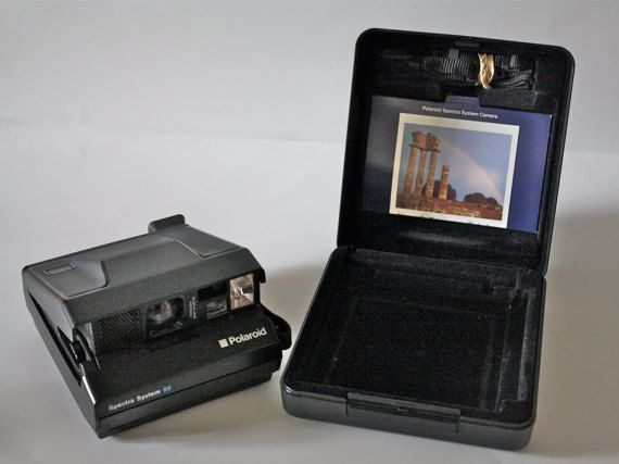 Check out this item in my Etsy shop https://www.etsy.com/listing/254628355/sale-vintage-polaroid-spectra-se-camera
