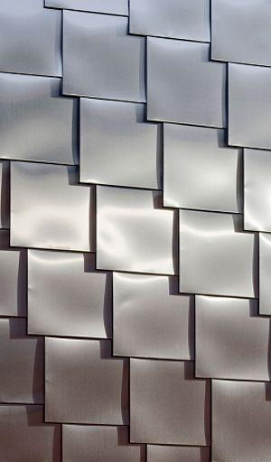 CIRKUS, SKANDIASCENEN BY WHITE (Åke E:son Lindman, Anders Bobert, Photography) Acabado exterior de tejuelas de metal, aplicado sobre superficie plana.