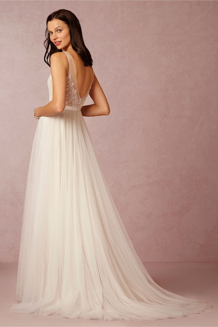 Love the Persiphone gown from @bhldn ...A sweeping train and intricate beaded embroidery with illusion straps, a sequined bodice, and a layered tulle skirt with tonal lining guarantees this ivory creation will make a dramatic (and unforgettable!) statement.