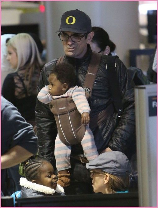 Actor Ty Burrell (Modern Family) wife Holly and their two adopted daughters Frances and ????**
