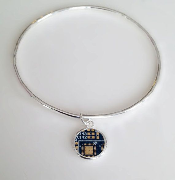 Hand made sterling silver hammered bangle bracelet with 14k gold and blue PCB board charm. This is the mother board from a Butterfly Labs