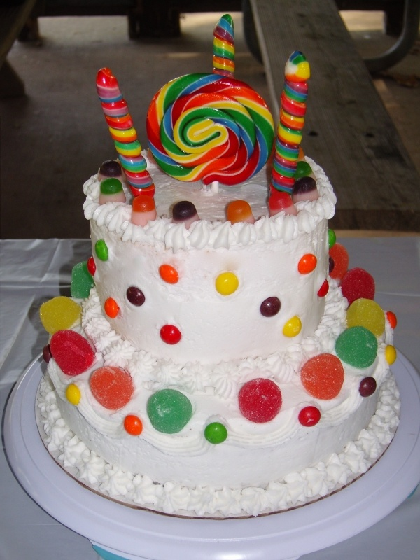 cake decorated with candyCandies Lollipops Cake, Candies Land, Chocolate Fudge, Anniversaries, Candyland Cake, Candy'S Lollipops Cake, Chocolates Fudge, Cake Decor With Candies, Birthday Cake