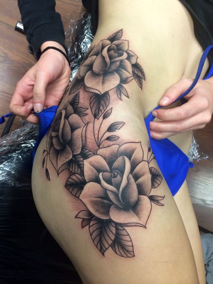 Amazing black-and-white rose flowers tattoo on thigh
