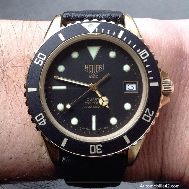 Heuer 1000 Submariner Man 18K plated gold with a black dial on a black Tropic Sport band 984.013L