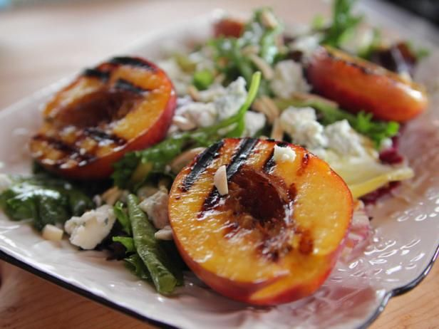 Grilled Nectarine Salad | Food Network. With almonds, blue cheese, salad greens, and a dijon honey dressing.