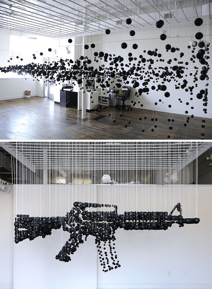 1200 Black Ping Pong Balls Form a Deadly Assault Rifle - My Modern Metropolis