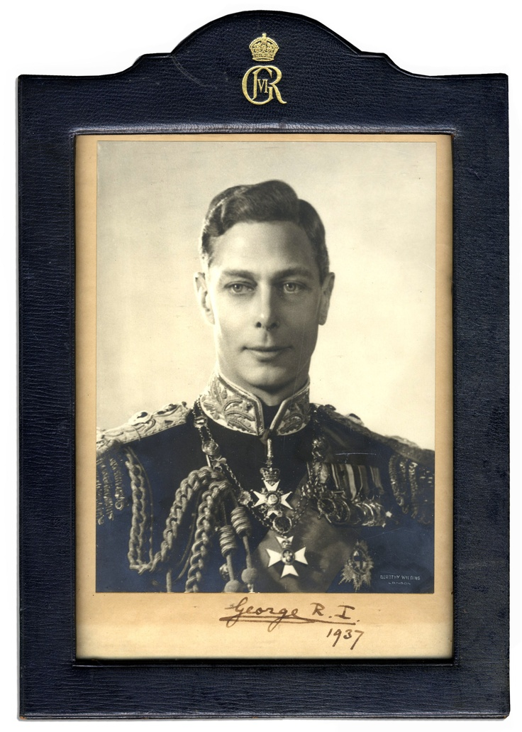 King George VI signed photo dated 1937. The King signs ''George R. I. / 1937'' on the border beneath an image of himself in full Naval regalia. George VI ascended the throne upon his brother's abdication a year prior to signing. His struggle with a stammer was documented in the 2010 Best Picture ''The King's Speech.'' Some toning to mount, but signature remains dark and bold; very good condition. In official Royal black leather frame with gilt Royal cypher.