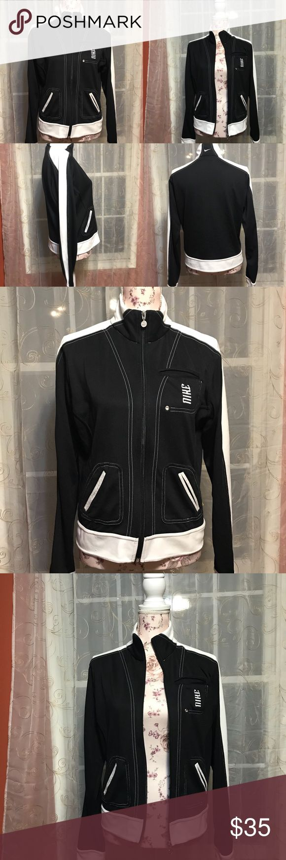 Nike black and white zip up Nike zip up size large no rips or stains working zipper logo embroidered on the back NIKE embroidered on front pocket has 3 small pockets 💕open to offers💕 Nike Jackets & Coats