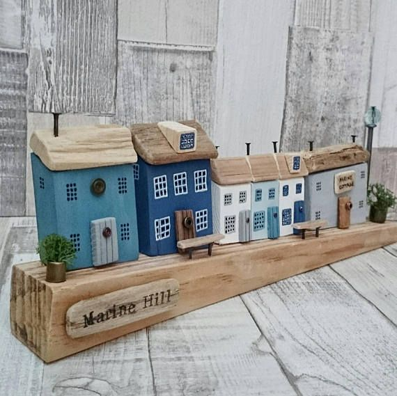 MARINE HILL Original Artwork by DriftwoodSails 🌊 This wood sculpture has been lovingly handcrafted using salvaged wood, weathered driftwood, chalk paint, nails, wire, washers. It is set on a gorgeous piece of reclaimed wood found on the Kent coast. A harbour scene of wooden houses