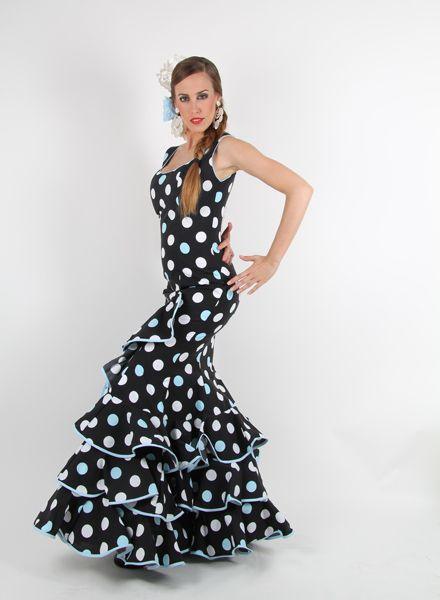 Trajes de flamenca Oferta Coral Turquesa de fondo negro con lunares blancos y turquesas de talle bajo con subida lateral y de tirantes. http://www.elrocio.es/41-trajes-de-flamenca-baratos
