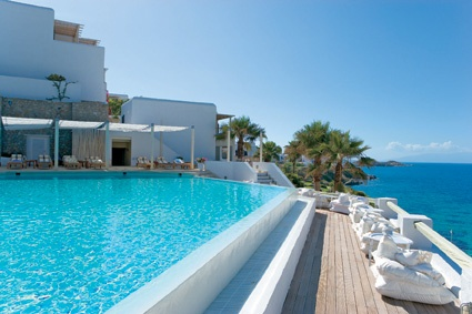 Unwind in lavish setting hovering over the famous #Psarou Beach