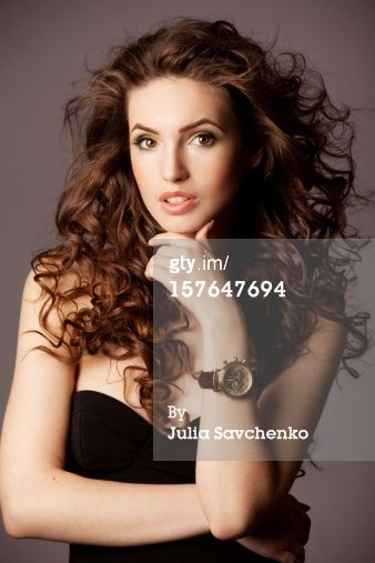 Title: Beautiful woman with watches Caption: Portrait of a fresh and lovely woman with watches Creative image #: 157647694 License type: Royalty-free Photographer: Julia Savchenko Collection: E+ Credit: Julia Savchenko Release information:This image has a signed model and property release. This image is available for commercial use. Copyright: Julia Savchenko