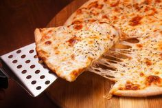 "DIY Dough Recipe: Thin Crust Pizza - ""The secret to a great thin crust [pizza is to allow the crust to proof in the fridge. This will prevent the pizza from puffing as it's cooked."""