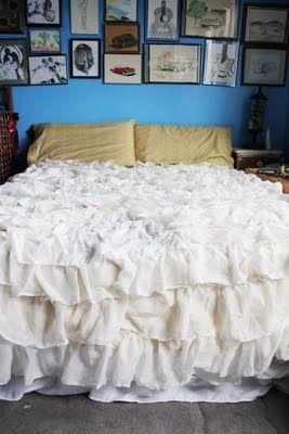 diy ruffle comforter. could use several different shades of yellow and make it fade from lighter to darker muted yellow