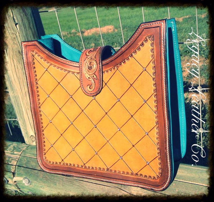 Custom Purse made by Legacy Leather Co. In Central Point, OR. Check out our website and order your dream tack, belt, etc! Www.facebook.com/legacyleather