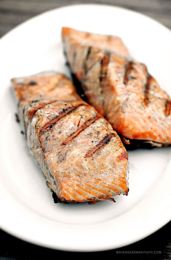 Perfect Grilled Salmon.  6-8 ounce skin-on salmon fillets, kosher salt, & olive oil. Preheat charcoal grill to 375. Cover all sides of fillets with light coating of olive oil. Sprinkle well with salt. Oil grill grate with high temp vegetable oil. Place fillets on grill, skin side down. Grill covered for 8 minutes. Flip & grill covered for an additional 3 minutes for medium. Adjust cook times to preferred doneness. Remove from grill & Enjoy. Optional: season with dill or lemon if desired.