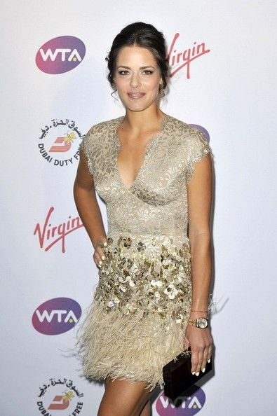 Ana Ivanovic Beaded Dress - Ana Ivanovic showed her glamorous side with this beaded and feathered gold cocktail dress at the pre-Wimbledon party.