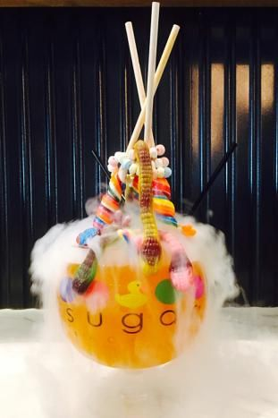 For Halloween, the Lollipop Brew at the Sugar Factory American Brassiere in Miami Beach comes dressed up with gummy snakes, spiders, and brains, along with lollipops and a candy necklace. The cocktail, which is served year-round minus the extra creepy crawlies, contains a wicked mix of Monin cantaloupe syrup, Bacardi coconut rum, Ketel One Citroen, grenadine, and pineapple juice.  Photo: Courtesy of Sugar Factory American Brassiere