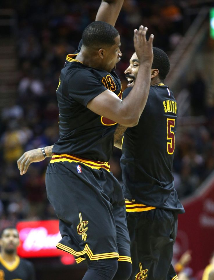 Cleveland Cavaliers center Tristan Thompson (13) bumps with Cleveland Cavaliers guard J.R. Smith (5) to celebrate his steal and layup in a game between the Cleveland Cavaliers and the Chicago Bulls at Quicken Loans Arena. Thursday, Feb.18, 2016