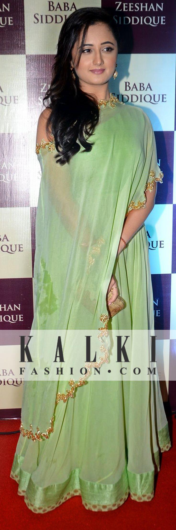 Dressed in a light green drop shoulder floor length dress with golden work, Rashmi was seen dazzling in style