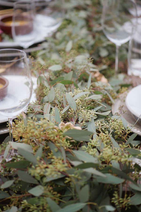 eucalyptus table runner, photo by Julie Paisley http://ruffledblog.com/cotton-field-winter-wedding-ideas #tablerunner #wedding