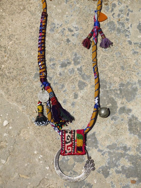Ethnic necklace with a hmong earring and uzbek tassels. Materials: tribal fabric, sterling silver, mixed silver beads, coin, tassels, vintage embroidery, glass bead