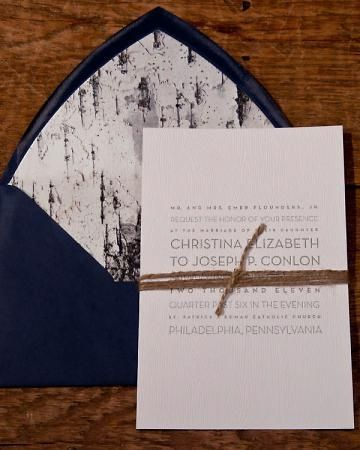 Embossed woodgrain paper creates a subtle background for this letterpressed invitation tied with twine