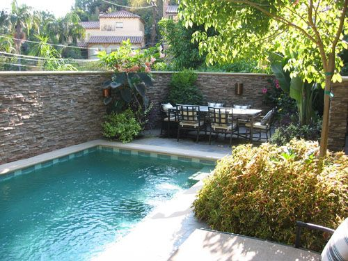 Swimming. New Pool With Retaining Walls Clad In Stone Veneer, Patio With  Slate Tile, And