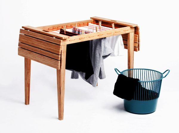 Living in a shoebox | Balcony table transforms into cloth dryer | The two Danish architecture students Anne Nørbjerg og Sanne Kyed Jeppesen noticed that urban balconys usually have either a café table or a cloth dryer, but rarely both, so they thought up Dryunder, a spacesaving piece of funiture that can be used as both table and dryer. Right now they are working on getting it on the market.