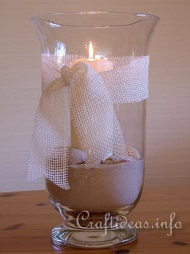 sand, seashells, and candle centerpiece