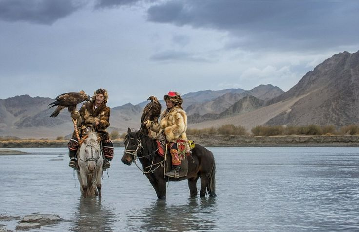 The Kazakh people take a break and cool off during the Golden Eagle Festival.