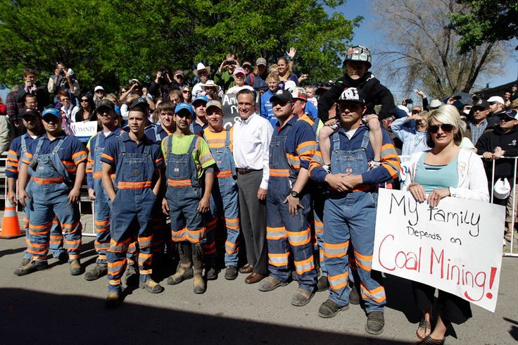 In 2012, Republican presidential candidate and former Massachusetts Governor Mitt Romney—a businessman who holds degrees from both Harvard Law School and Harvard Business School and whose personal fortune is worth roughly $250 million dollars—poses for a photo with coal miners after a campaign event in May 2012 in Craig, Colorado.