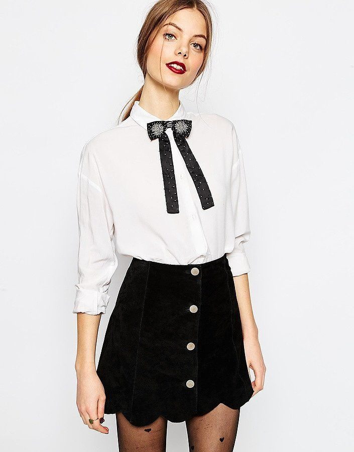White button up with string tie and black button skirt