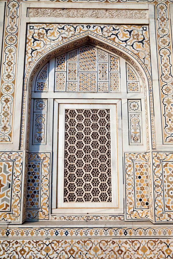 "Agra, India. Geometric Window Design, with Pietra Dura Stone Work. Itimad-ud-Dawlah, Mausoleum of Mirza Ghiyas Beg. The tomb is sometimes referred to as the ""Baby Taj."" It is one of the finest examples of pietra dura work, making designs through the use of inlaid colored stone. COPYRIGHT:© Charles O. Cecil"