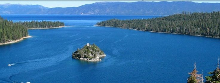 """Emerald Bay State Park, South Lake Tahoe, CA.  Take a boat out and camp on the only island in Lake Tahoe.  In 1969, Emerald Bay was designated a National Natural Landmark for its brilliant panorama of mountain-building processes and glacier carved granite.  The park features Vikingsholm, one of the finest examples of Scandinavian architecture in the western hemisphere and the """"Tea House"""" on Fannette Island, the only island to be found in all of Lake Tahoe."""