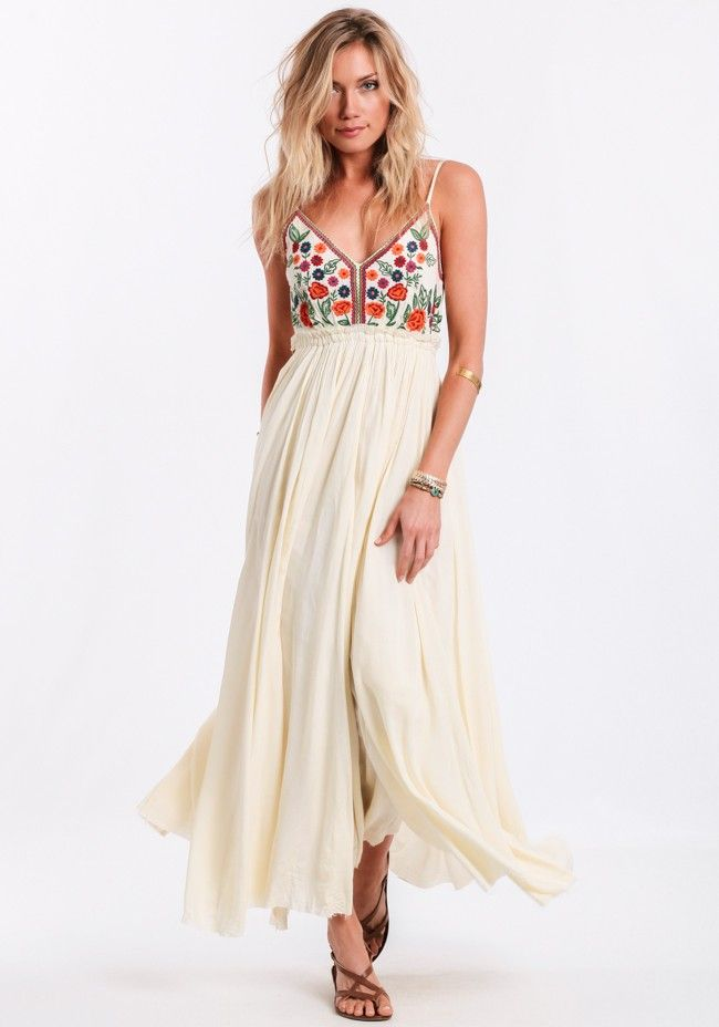 Ultra-soft breezy cream-colored maxi dress featuring a colorful floral embroidered bust that goes into a sultry open back with raw-edged hems. Pair this bohemian maxi with strappy   The Isabella Embroidered Maxi Dress By Raga     S: TS079      Model #: 15680 $162.00