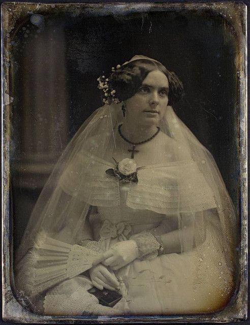 An unidentified Victorian bride looking radiantly lovely in her elegant, feminine white dress and veil. #Victorian #photograph #antique #vintage #woman #daguerreotype #wedding #bridge #dress #veil #1850s