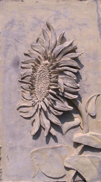 Jason Kewley Concrete Art - Sunflower  https://www.facebook.com/pages/Jason-Kewley-concrete-artwork/157442954427553?fref=ts Concrete artwork can also be found at Studio 11 in Emporia, Ks.