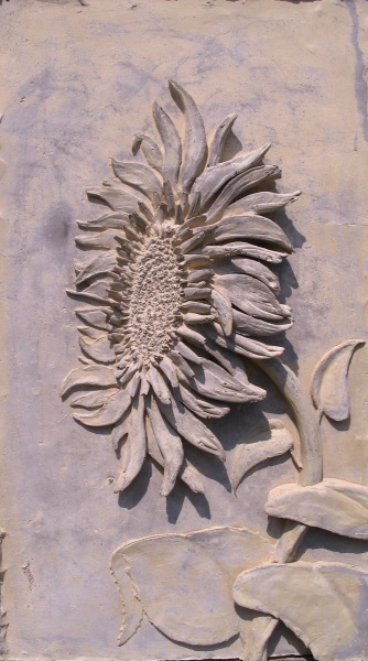 Jason Kewley Concrete Art - Sunflower  https://www.facebook.com/pages/Jason-Kewley-concrete-artwork/157442954427553?fref=ts Concrete artwork can also be found at Studio 11 in Emporia, Ks.
