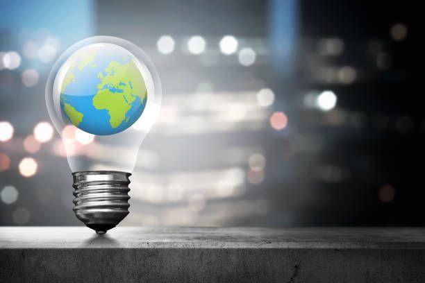 portrait of earth inside light bulb over blurred light