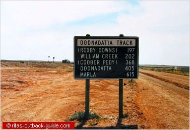 Road sign showing distances along an Outback track in South Australia