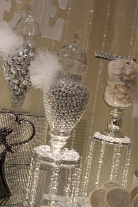 Wedding candy display with tulle, crystals, and sparkles that command attention.  See more wedding candy buffets and party ideas at www.one-stop-party-ideas
