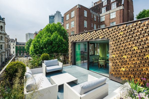 A Leaf Covered House Grows in London in architecture  Category