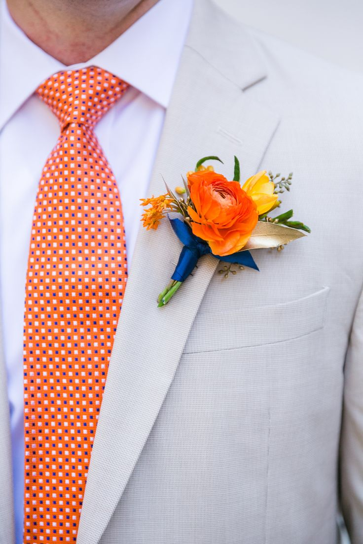 Orange, navy, and gold boutonniere.  Tan suits and orange ties.  Wildflowers Inc.  Dana Cubbage Photography.